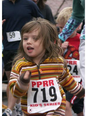 Kyla Carpenter - Here am I having a blast at the 2005 Manitou Spgs Mayors Cup! Do you think I like to run?