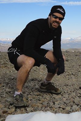 Sean O'Day - Atop San Luis Peak, July 2010.  I really had to squat down to fit in this picture, right?